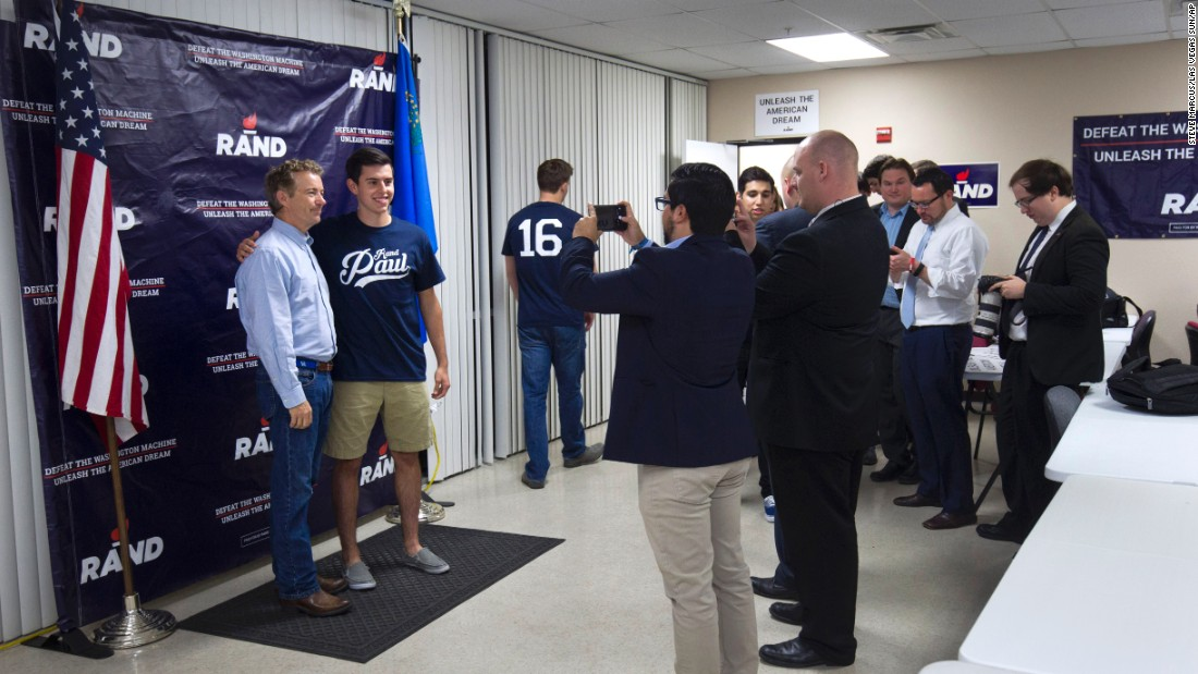 Republican presidential candidate Rand Paul poses with members of Students for Rand Paul during the opening of his campaign office in Las Vegas on Monday, October 26.