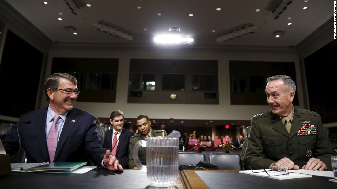 Secretary of Defense Ash Carter, left, and Joint Chiefs of Staff Chairman Joseph Dunford chat before testifying on Tuesday, October 27, at a Senate Armed Forces Committee hearing in Washington on U.S. strategy in the Middle East.