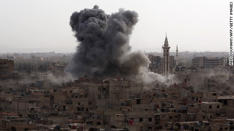 Smoke billows from the Syrian rebel-held area of Douma, east of the capital Damascus, following a reported air strike by government forces on September 16, 2015.