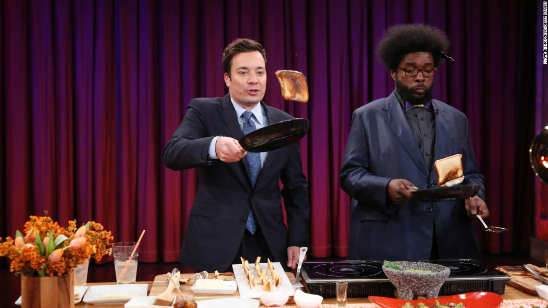 "For comfort food on a cold day, it's hard to beat a toasty grilled cheese sandwich and a bowl of tomato soup. Here Jimmy Fallon and bandleader Questlove try their hand at flipping the sandwiches on a 2013 episode of ""Late Night with Jimmy Fallon."""