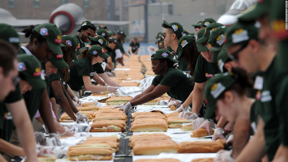 "Served on a long roll, the submarine or ""sub"" sandwich is also known by other regional names, including hero (New York) and hoagie (Philly). Workers in New York City set a Guinness World Record in 2013 by making 2,706 hero sandwiches in an hour."