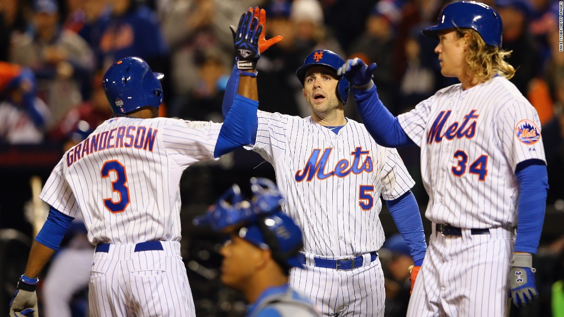 New York Mets Curtis Granderson, from left, celebrates with David Wright and Noah Syndergaard after hitting a two-run home run.