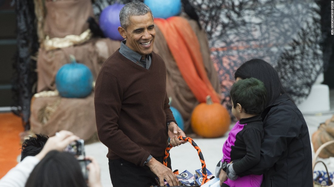 President Obama hands out treats to children trick-or-treating for Halloween on the South Lawn of the White House on October 30.