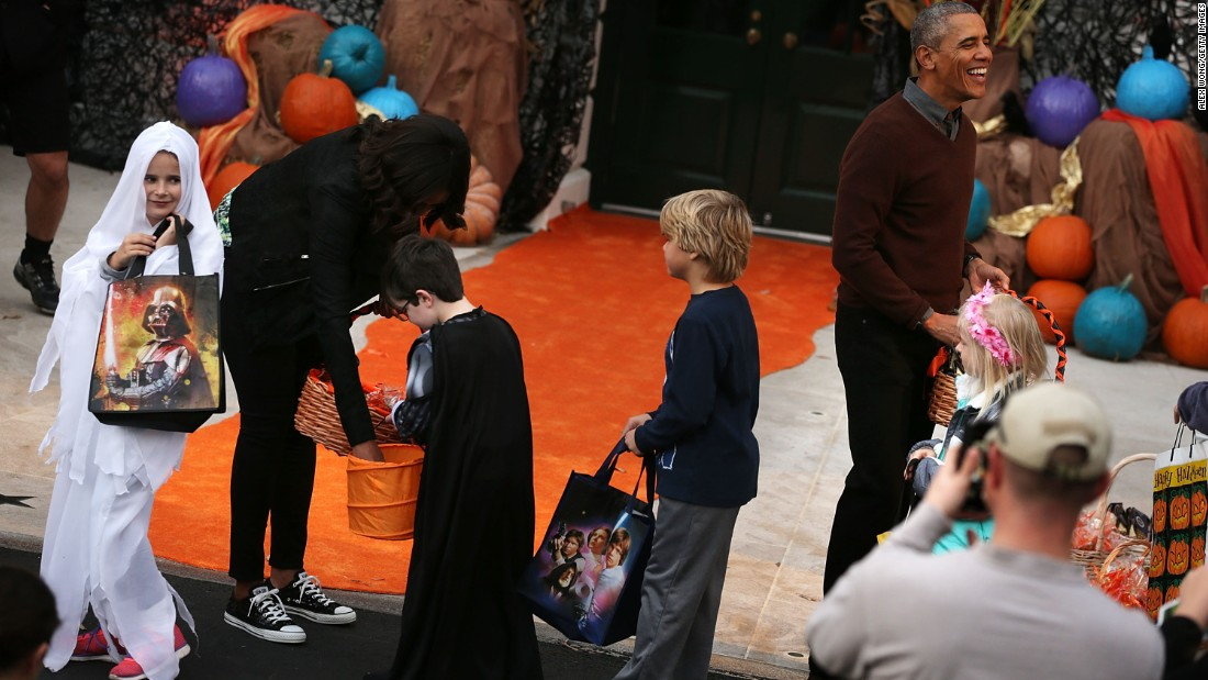 President Obama (right) and the first lady hand out treats during a Halloween event at the South Lawn of the White House on October 30.