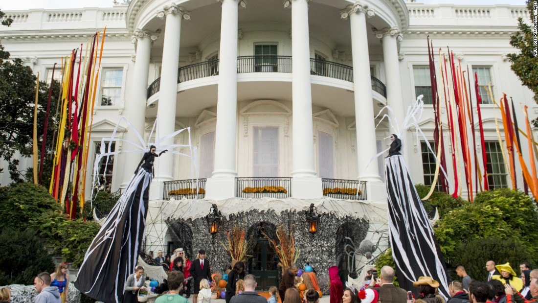President Obama and the first lady join a crowd of trick-or-treaters on the South Lawn of the White House on October 30.