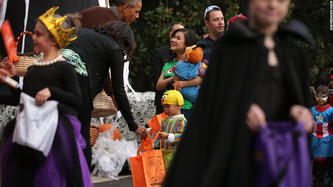 President Obama and the first lady hand out treats during a Halloween event at the South Lawn of the White House on October 30.