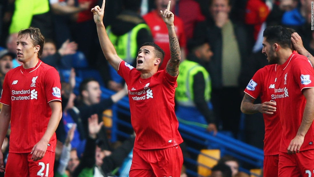 Philippe Coutinho signals his delight after scoring his second goal in the 3-1 win for Liverpool at Chelsea.