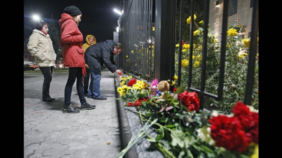 People light candles and leave flowers at the Russian Embassy in Kiev, Ukraine, on October 31.