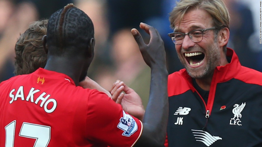 A delighted Klopp celebrates his team's win at Stamford Bridge with Mamadou Sakho.