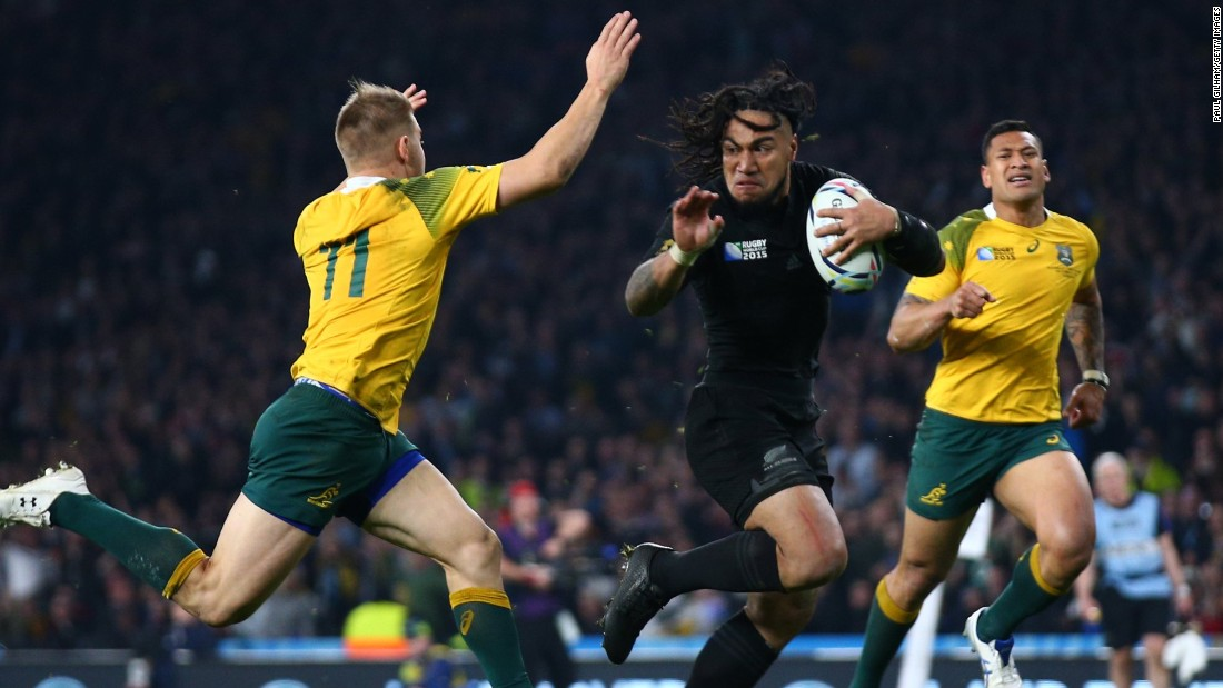 Ma'a Nonu of New Zealand hands off Drew Mitchell of Australia on the way to score his team's second try of the final early in the second half.