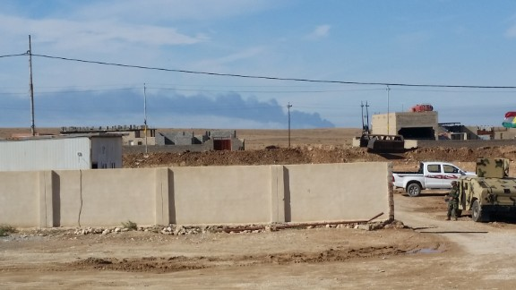 A smoke plume rises as coalition planes bomb an ISIS position