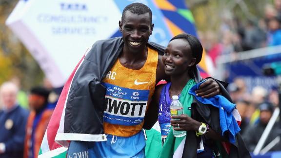 Pro Men's Division winner Stanley Biwott of Kenya, left, poses with Pro Women's Division winner Mary Keitany, also of Kenya.