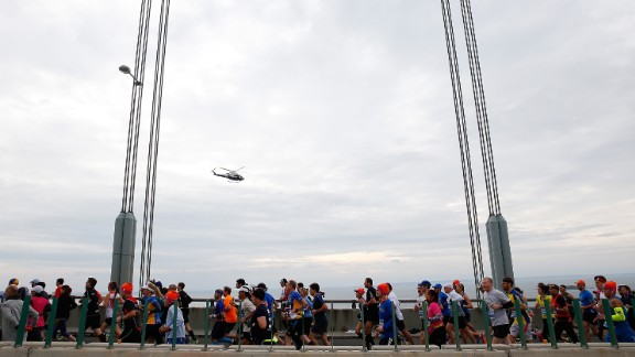 Runners cross the Verrazano-Narrows Bridge at the start of the TCS New York City Marathon on November 1 in New York City. The marathon has grown from a Central Park race with 55 finishers in 1970 to the world's biggest and most popular marathon, with 50,530 finishers in 2014.