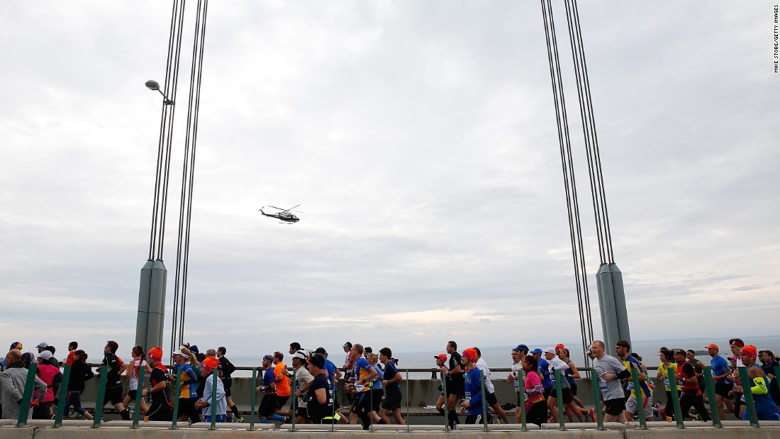 "Runners cross the Verrazano-Narrows Bridge at <a href=""http://bleacherreport.com/articles/2584896-new-york-marathon-results-2015-mens-and-womens-top-finishers?utm_source=cnn.com&utm_medium=referral&utm_campaign=editorial"" target=""_blank"">the start of the TCS New York City Marathon</a> on November 1 in New York City. The marathon has grown from a Central Park race with 55 finishers in 1970 to the world's biggest and most popular marathon, with 50,530 finishers in 2014."