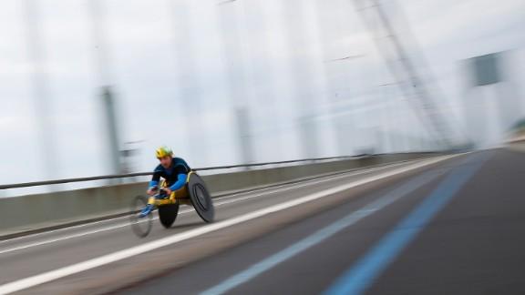 An athlete in the Wheelchair Division crosses the Verrazano-Narrows Bridge.