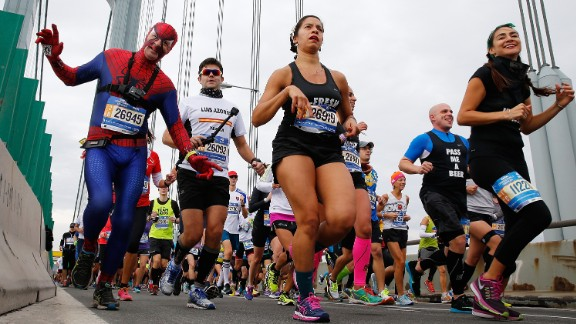 A costumed runner, like this Spiderman, is not an unusual sight amid runners.