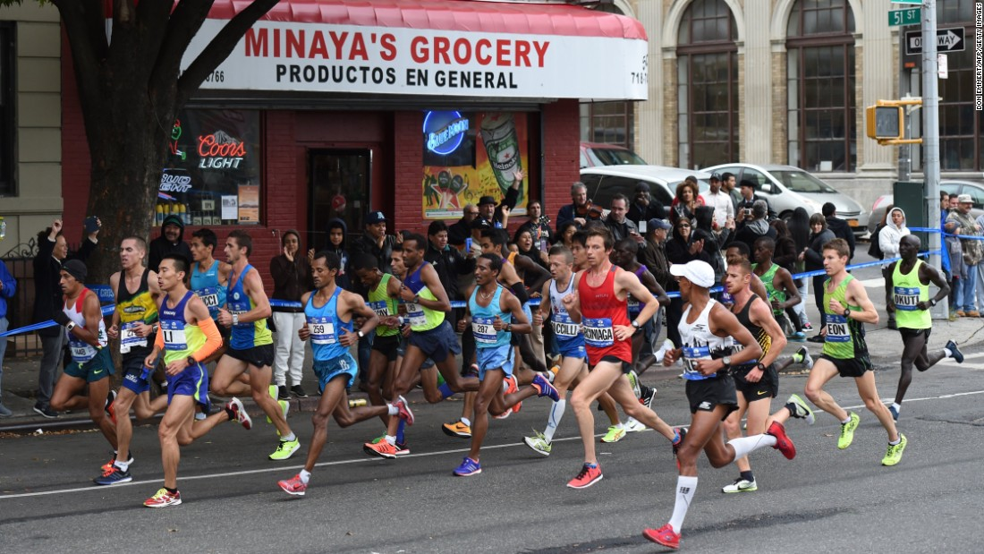 Elite runners make their way through the streets of Brooklyn during the marathon.