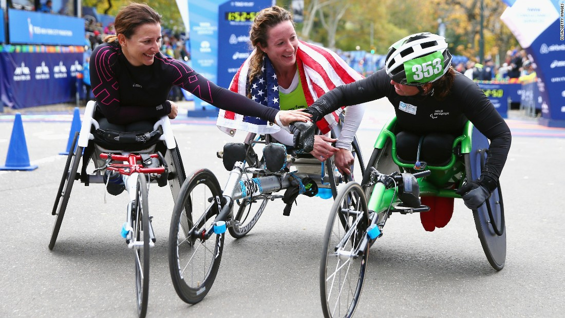 Manuela Schar of Switzerland (2nd place), from left, Tatyana McFadden of the United States (1st), and Sandra Graf of Switzerland (3rd), react after finishing the Women's Professional Wheelchair Division.
