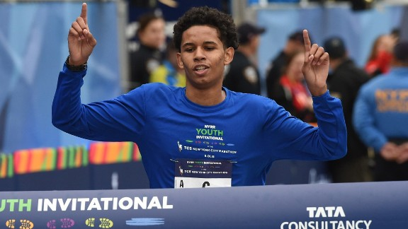 Matthew Nieves, 16, from New York's Bishop Loughlin High School, crosses the finish line to win the inaugural New York Road Runners Youth Invitational event of the marathon.