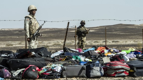 Egyptian army soldiers guard the luggage and other belongings of passengers piled up at the site of the crash on November 1.