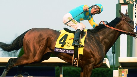 American Pharoah, ridden by Victor Espinoza, wins the Breeders' Cup Classic to cap his superb career.