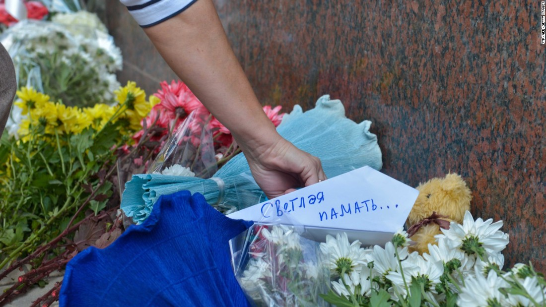 People place flowers and messages in front of the Russian Embassy in Cairo on November 1.