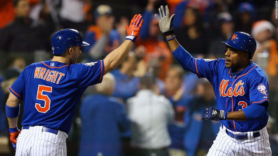 Curtis Granderson of the New York Mets celebrates with David Wright after hitting a solo home run.