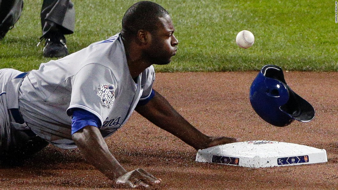 Kansas City Royals' Lorenzo Cain is safe after stealing second base against the New York Mets during the first inning.