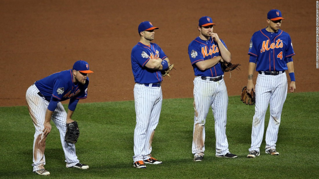 New York Mets' (from left) Lucas Duda, David Wright, Daniel Murphy and Wilmer Flores look on during a pitching change in the ninth inning.