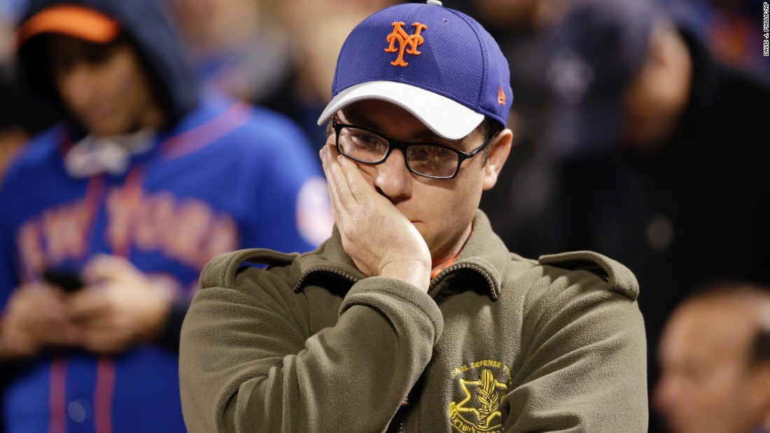 A New York Mets fan reacts during the 12th inning.