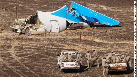 Egyptian military personnel stand near the tail of crashed Kogalymavia Flight 9268 in Hassana, Egypt, on Sunday, November 1.