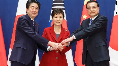 Then-South Korean President Park Geun-Hye (C) poses with Japanese Prime Minister Shinzo Abe (L) and Chinese Premier Li Keqiang (R) on November 1, 2015 in Seoul, South Korea.