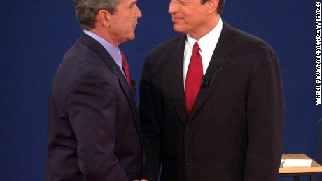 George W. Bush shakes hands with Al Gore after their third debate in October 2000.