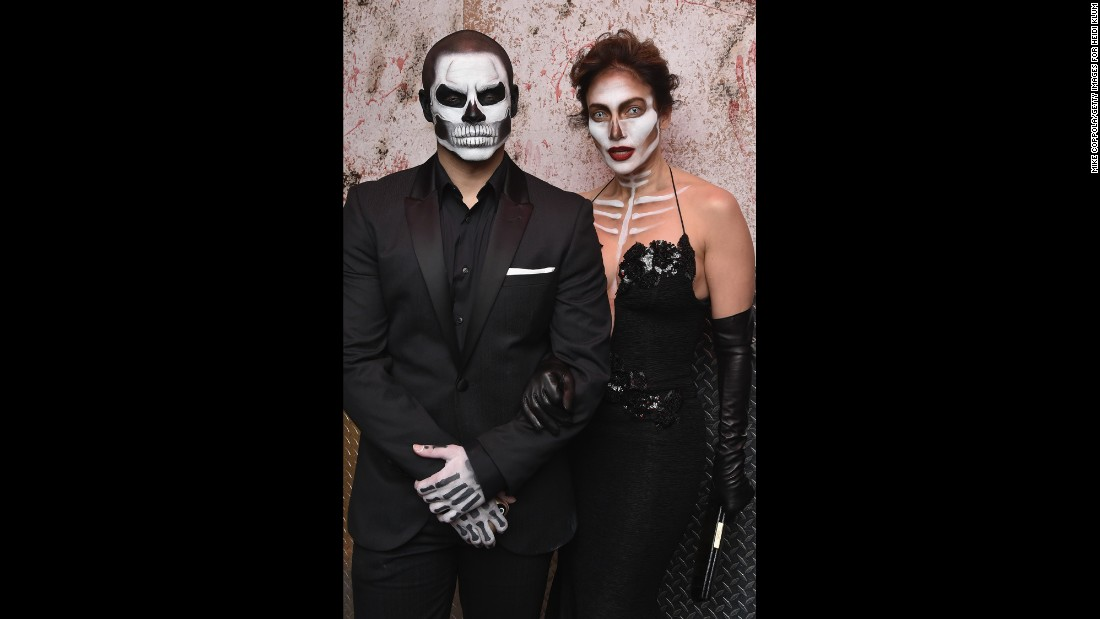 Singer-actress Jennifer Lopez and boyfriend Casper Smart dress as stylish skeletons for Heidi Klum's Halloween party.