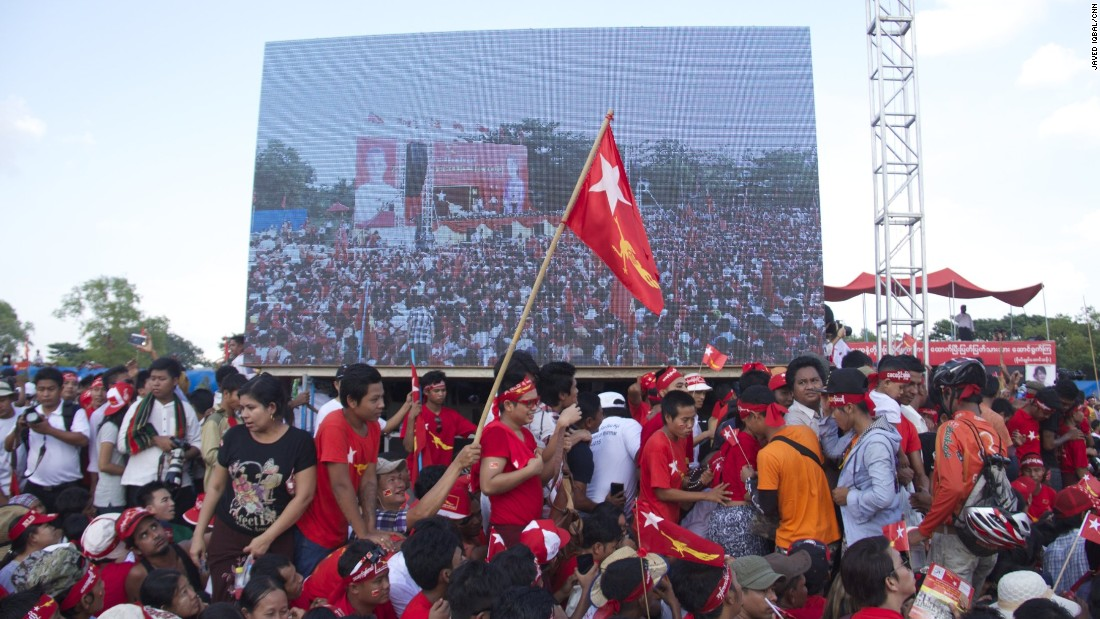 Supporters of Aung San Suu Kyi's opposition party, the National League For Democracy (NLD), are decked in the red of her party.