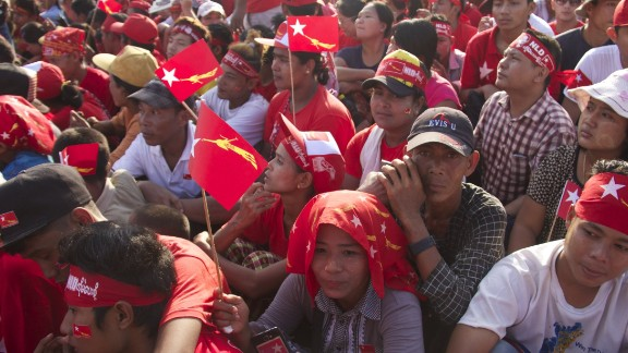 Supporters of the NLD cram the streets in a river of red shirts and flags during the November 1 rally.