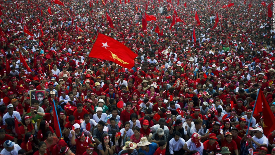 Supporters fill the streets in a river of red shirts and flags at a campaign rally for the National League for Democracy in Yangon on November 1.