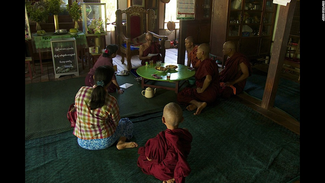 People sit at the Buddhist monastery Meiktila Burma, where U Wie Douktah gave shelter to Muslims in 2013.