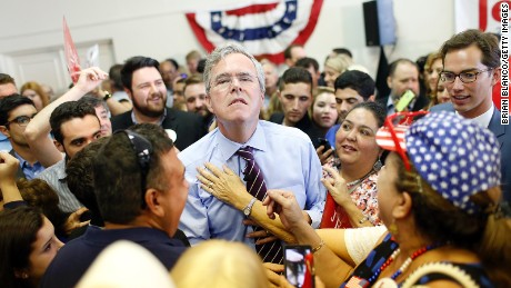 "Republican presidential candidate and former Florida governor Jeb Bush allows a supporter to loosen his necktie during a rally on his ""Jeb Can Fix It"" Tour on November 2, 2015 at the Tampa Garden Club in Tampa, Florida."