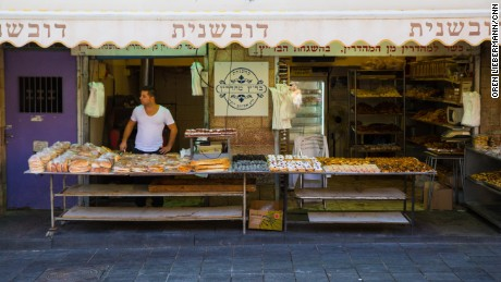 Idan Sharabi waits for customers at his pastry shop in Jerusalem's Mahane Yehuda market.