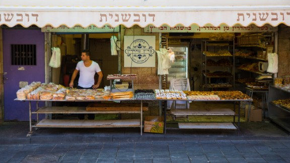 Idan Sharabi waits for customers at his pastry shop in Jerusalem's Mahane Yehuda market.