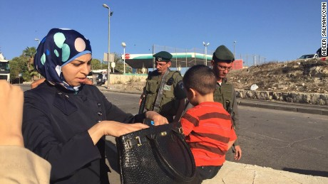 Israeli security forces check Palestinians in East Jerusalem.