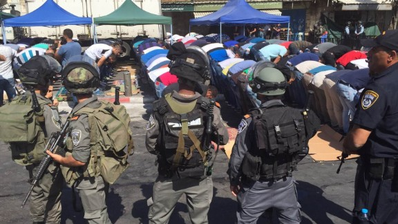 Israeli security forces surround Muslim worshipers during Friday prayers outside the Old City of Jerusalem.