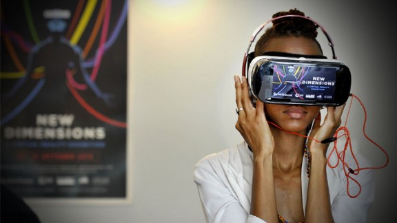 A woman tries a virtual reality headset.