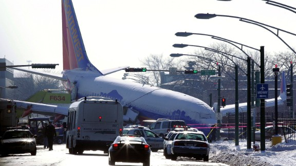 While attempting to land in a snowstorm, this Southwest Airlines jet skidded off the runway in Chicago Midway International Airport and crashed into a line of cars, killing a toddler.