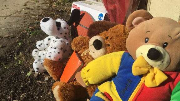 Mourners placed stuffed animals and a basketball in the alley where 9-year-old Tyshawn Lee was shot to death.