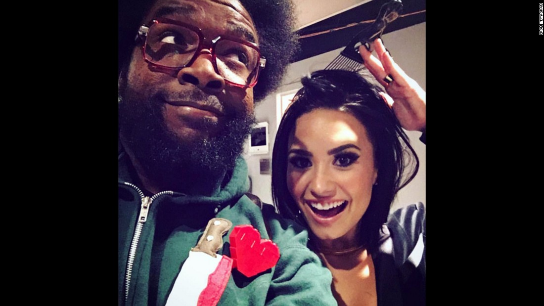 "Singer Demi Lovato dons Questlove's signature hair pick on Tuesday, November 3. ""Thanks @questlove for the new hair accessorie... #twinsies,"" <a href=""https://instagram.com/p/9nMUj3uKq1/?taken-by=ddlovato"" target=""_blank"">she said on Instagram.</a>"