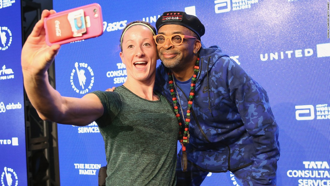 Paralympic athlete Tatyana McFadden takes a selfie with film director Spike Lee at a news conference Thursday, October 29, for the New York City Marathon.