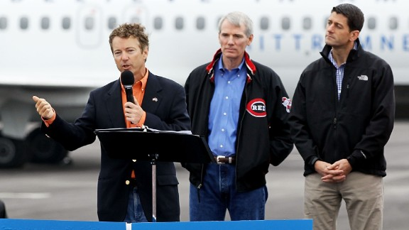 U.S. Sen. Rand Paul (R-KY) (L) campaigns for Republican presidential candidate and former Massachusetts Governor Mitt Romney (R) and his running mate U.S. Rep. Paul Ryan (R-WI) (3rd L) as U.S. Sen. Rob Portman (R-OH) (2nd L) looks on during a campaign rally September 25, 2012 at Dayton International Airport in Vandalia, Ohio.