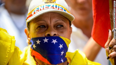 A Venezuelan opposition activist takes part in a peaceful demonstration in Caracas, on June 20, 2015 demanding to the government of President Nicolas Maduro the release of political prisoners and the setting of a date for the parliamentary elections. AFP PHOTO / FEDERICO PARRA        (Photo credit should read FEDERICO PARRA/AFP/Getty Images)